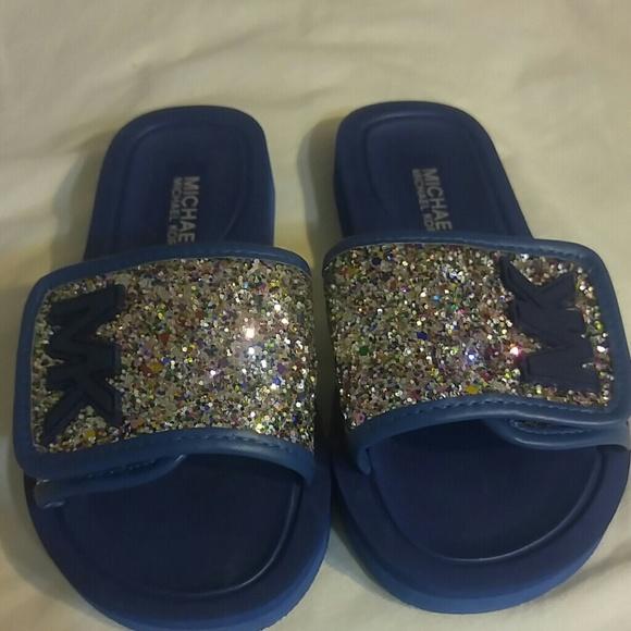724d2798ad43 NWOT Michael Kors Eli glow glitter slide sandal. M 5b8bf232df03073414a2a3cb